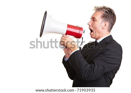 Elderly business man screaming loudly in a megaphone