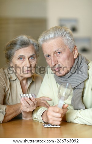 Elderly caucasian couple ill with influenza at home