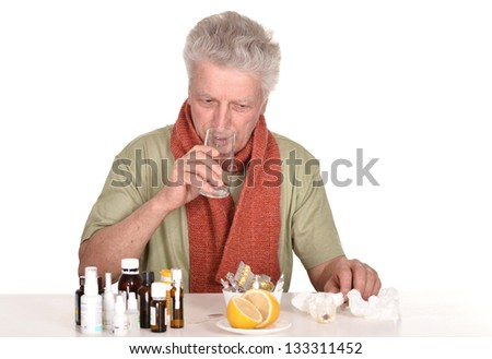 elderly caucasian man treated by medicines on a white background