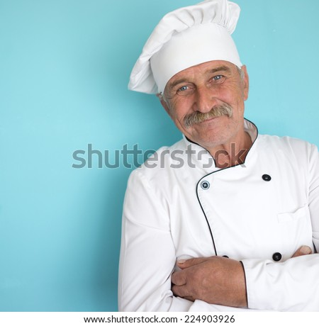 Elderly chef in white cook uniform - stock photo