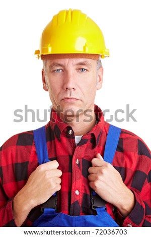 Elderly construction worker with yellow hard hat - stock photo