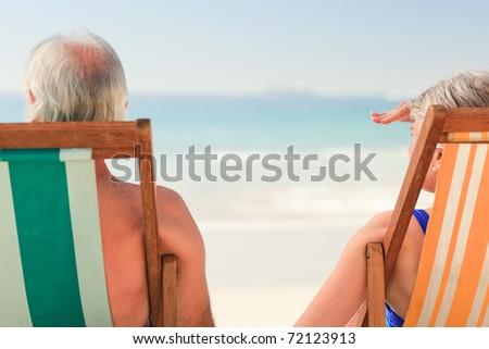 Elderly couple at the beach - stock photo