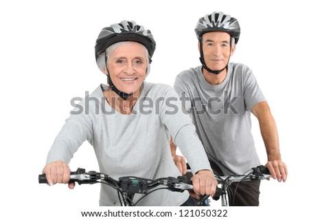 Elderly couple cycling - stock photo