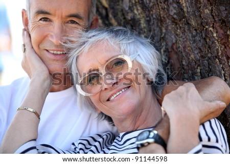 Elderly couple enjoying each other's company - stock photo