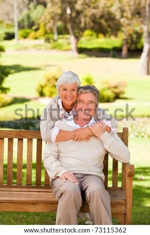 Elderly couple in the park - stock photo