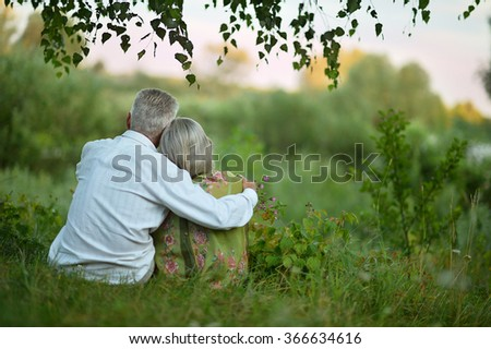 Elderly  couple on nature  at summer