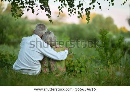 Elderly  couple on nature  at summer - stock photo