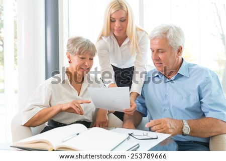 Elderly couple purchasing life insurance - stock photo