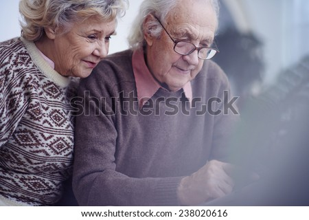 Elderly couple spending leisure together - stock photo
