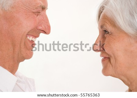 elderly couple together on a white background - stock photo