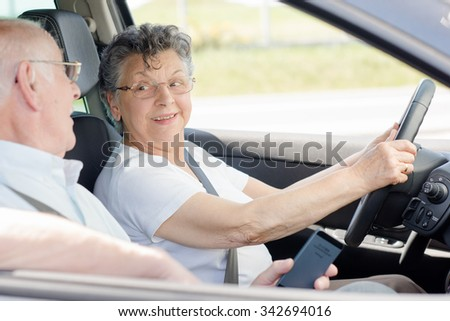 elderly couple travelling