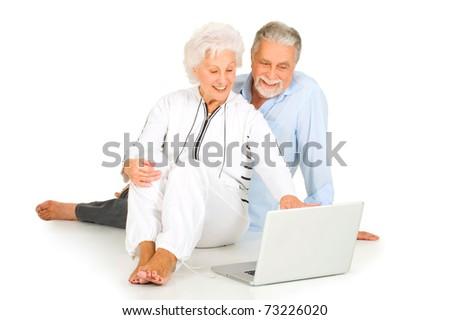 elderly couple using laptop - stock photo