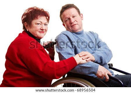 Elderly couple with man sitting in wheelchair