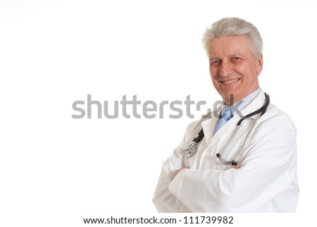 Elderly doctor in a white coat with a stethoscope - stock photo