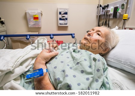 Elderly eighty plus year old woman in a hospital bed. - stock photo