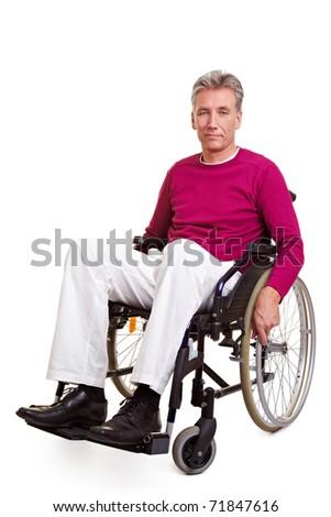 Elderly handicapped man sitting in a wheelchair - stock photo