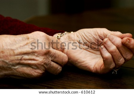 Elderly hands - stock photo