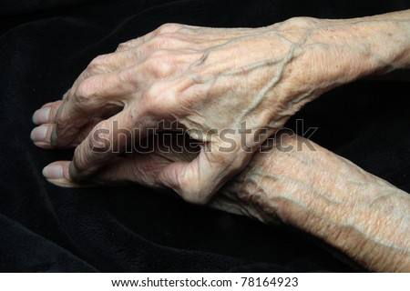 elderly hands of a woman - stock photo