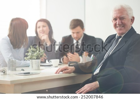 Elderly happy entrepreneur during business meeting - stock photo