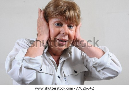 elderly lady with earache - stock photo