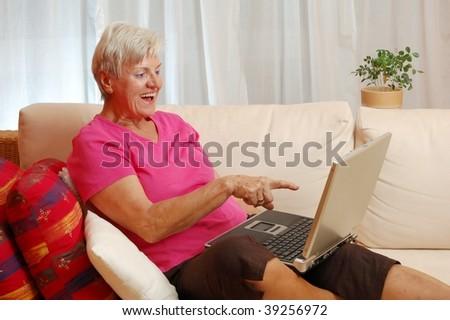 Elderly Lady with Laptop - stock photo