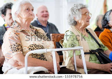 elderly man and woman sitting  - stock photo