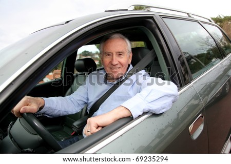 Elderly man driving a car