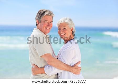 Elderly man embracing her wife - stock photo