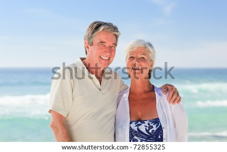 Elderly man embracing his wife