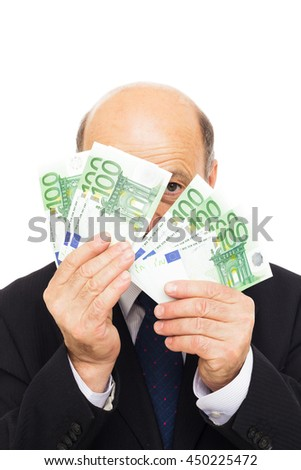 elderly man hides beside money