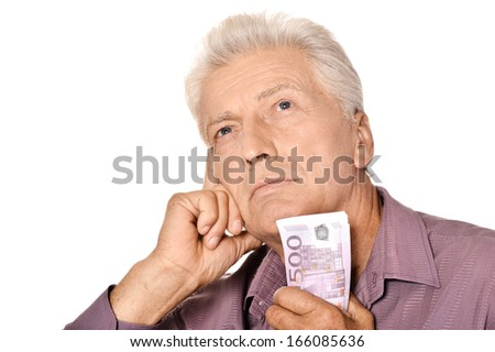 Elderly man holding euros isolated on white background