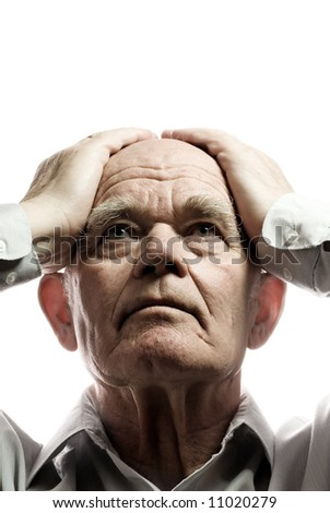 Elderly man in despair. Isolated on white background - stock photo