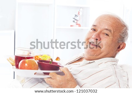 elderly man in the hospital bed - stock photo