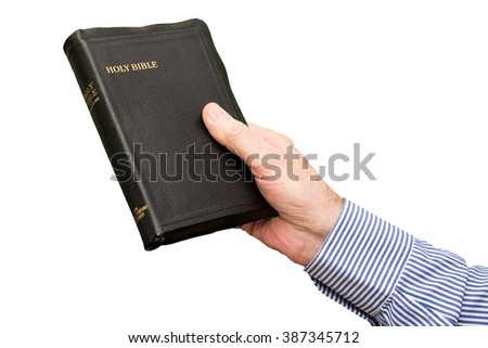 Elderly man is holding bible on white background, color and contrast manipulated - stock photo