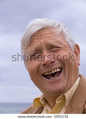 Elderly man laughing - stock photo