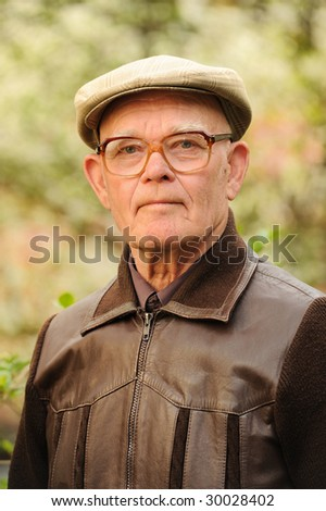 Elderly man outdoors - stock photo