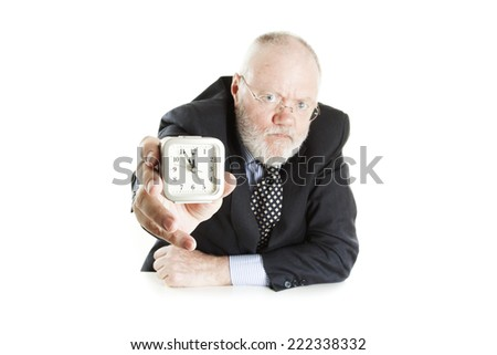 Elderly man posing on white background and showing time, please, expect narrow focus - stock photo