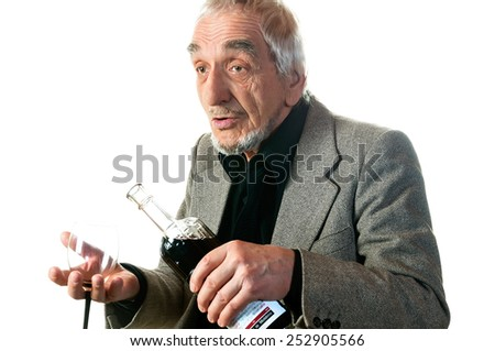 elderly man preparing to pour a glass of wine on a white background - stock photo