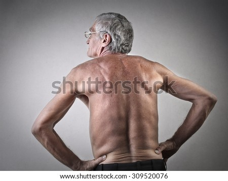 Elderly man's back - stock photo