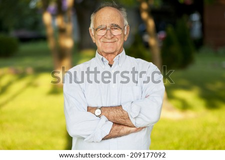 Elderly Man Smiling At The Camera - stock photo