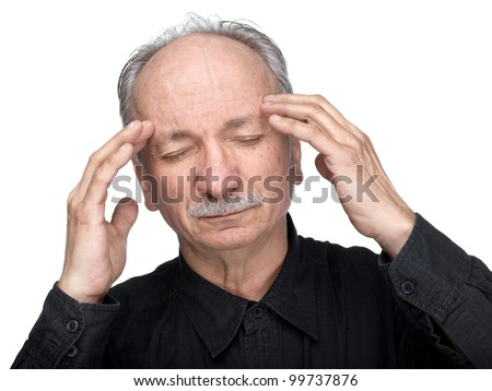 Elderly man suffering from a headache isolated on white