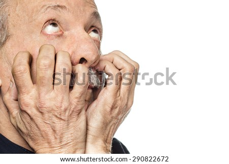 Elderly man suffering from a headache isolated on white with copy-space - stock photo