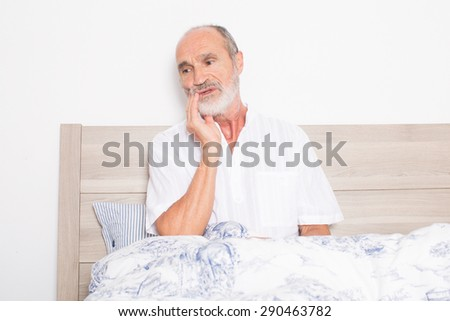 Elderly man suffering from toothache - stock photo