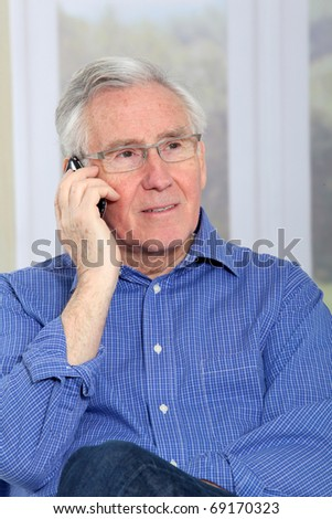 Elderly man talking on mobile phone - stock photo