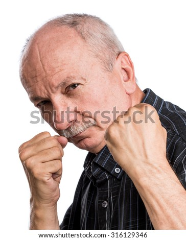 Elderly man threatening with a fists on a white background