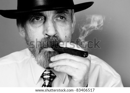 elderly man with cigar - stock photo