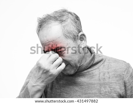 Elderly man with eyes pain touching his eyes