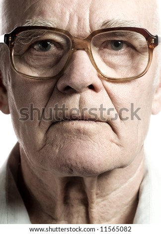 Elderly man with massive glasses - stock photo
