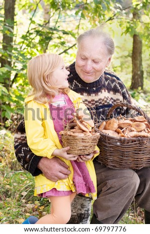 elderly men and little girl in forest - stock photo