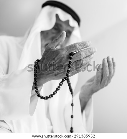 Elderly Muslim Arabic man praying - stock photo